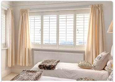 tranquil bedroom with wooden shutters